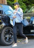 Katherine Schwarzenegger covers her baby bump and face with a mask while visiting her Mom in Brentwood, California