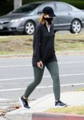 Katherine Schwarzenegger wears a face mask with an oversized shirt and leggings for an afternoon stroll in Santa Monica, California