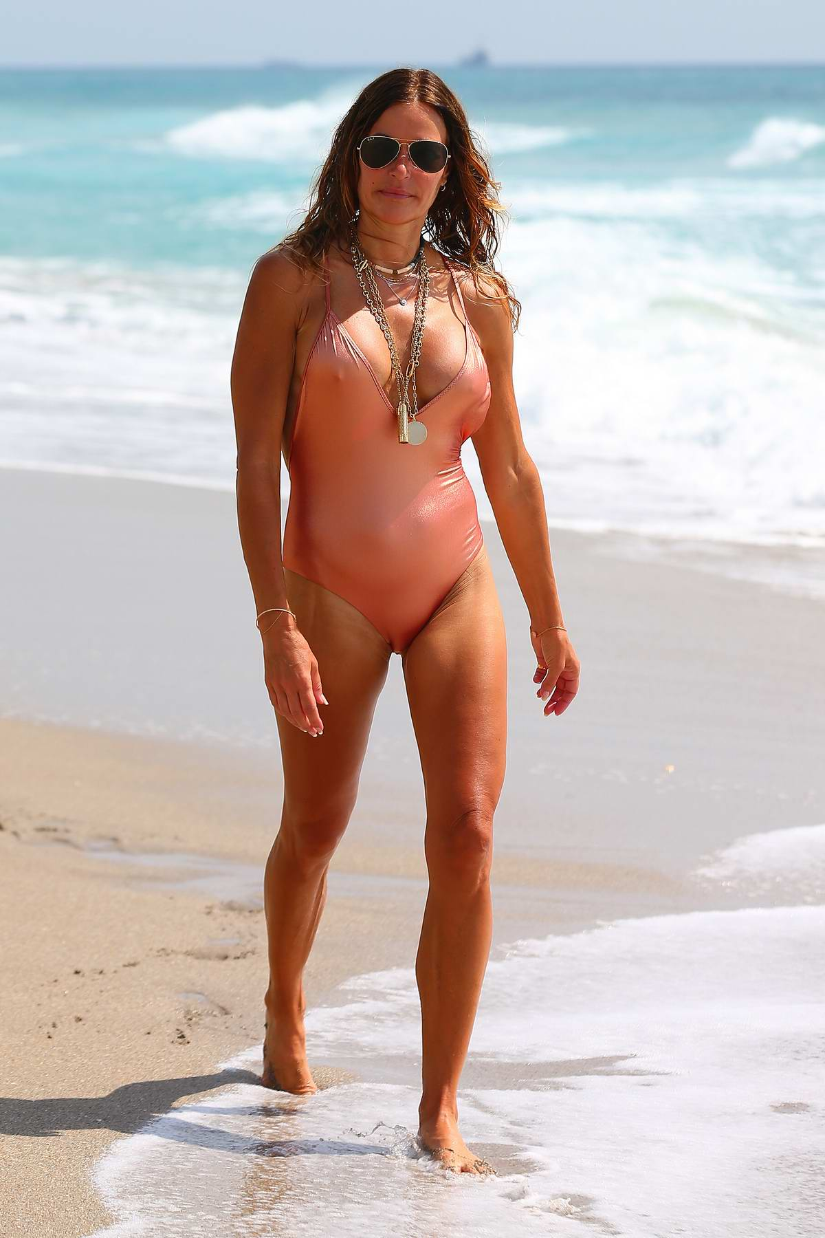 Kelly Bensimon spotted in a peach colored swimsuit as she enjoys the beach in Palm Beach, Florida