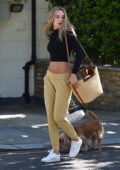 Kimberley Garner shows off her perfect abs in a black crop top while out shopping in London, UK