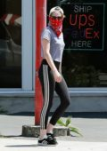Kristen Stewart sports a grey top with black Adidas leggings as she grabs coffee with friends in Los Feliz, California