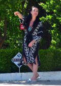 Kyle Richards stepped out of her house in a chic robe to greet her friend Sutton Stracke in Beverly Hills, California