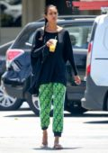 Lais Ribeiro enjoys a smoothie during a grocery run in Malibu, California