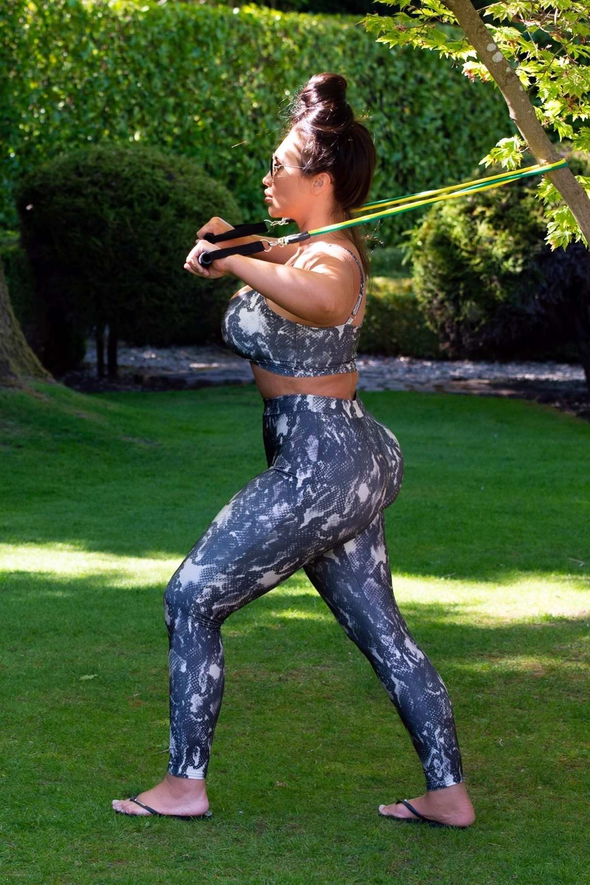 Lauren Goodger sports snakeskin print crop top and leggings during an early morning workout at a local park in Essex, UK