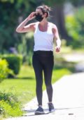 Lea Michele displays her baby bump in tank top and leggings while out for a walk in Santa Monica, California