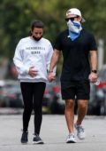 Lea Michele seen caressing her pregnant belly while out for a stroll with husband Zandy Reich in Los Angeles
