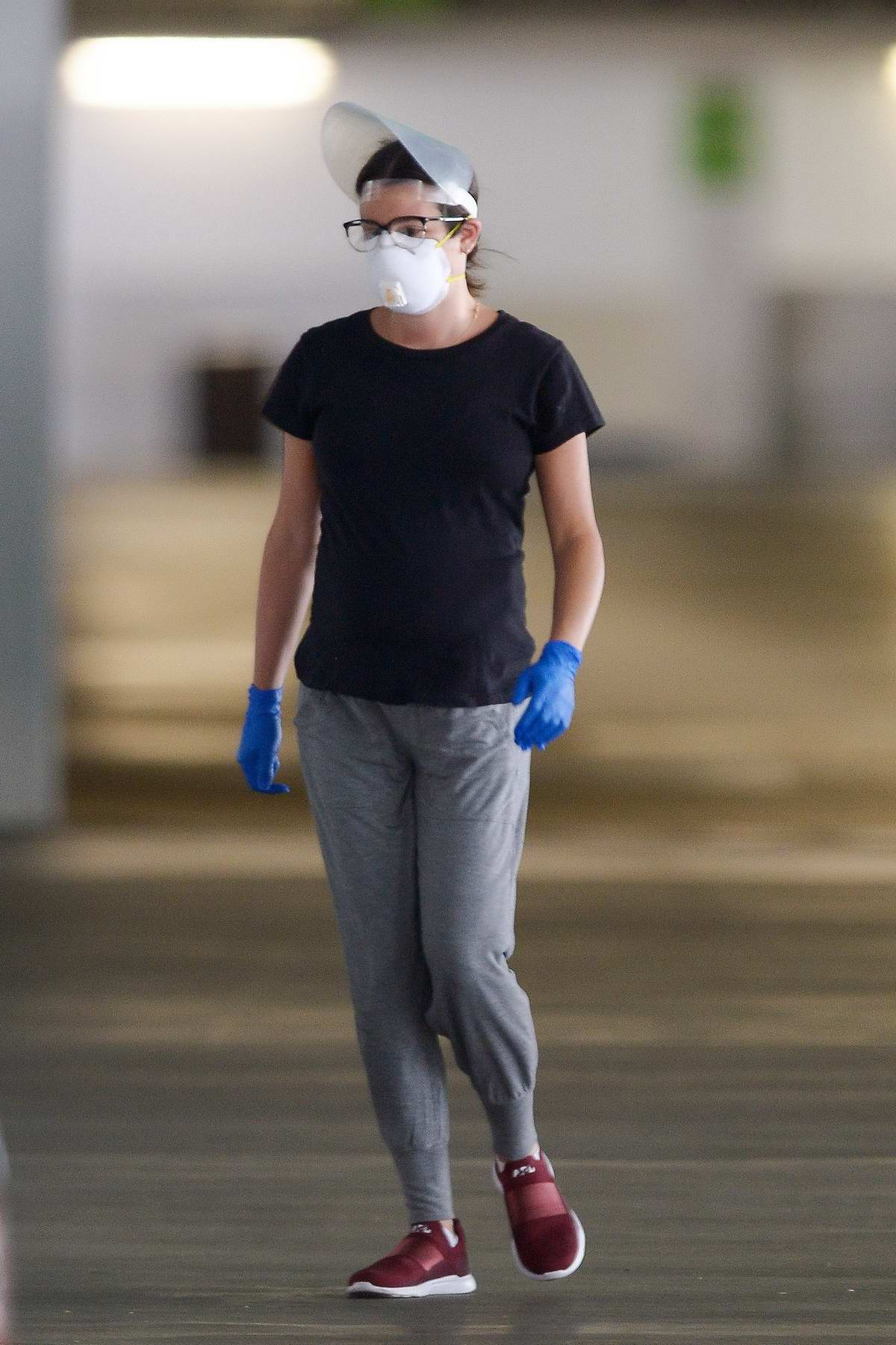 Lea Michele wears a face shield along with a face mask while out with husband Zandy Reich in Los Angeles