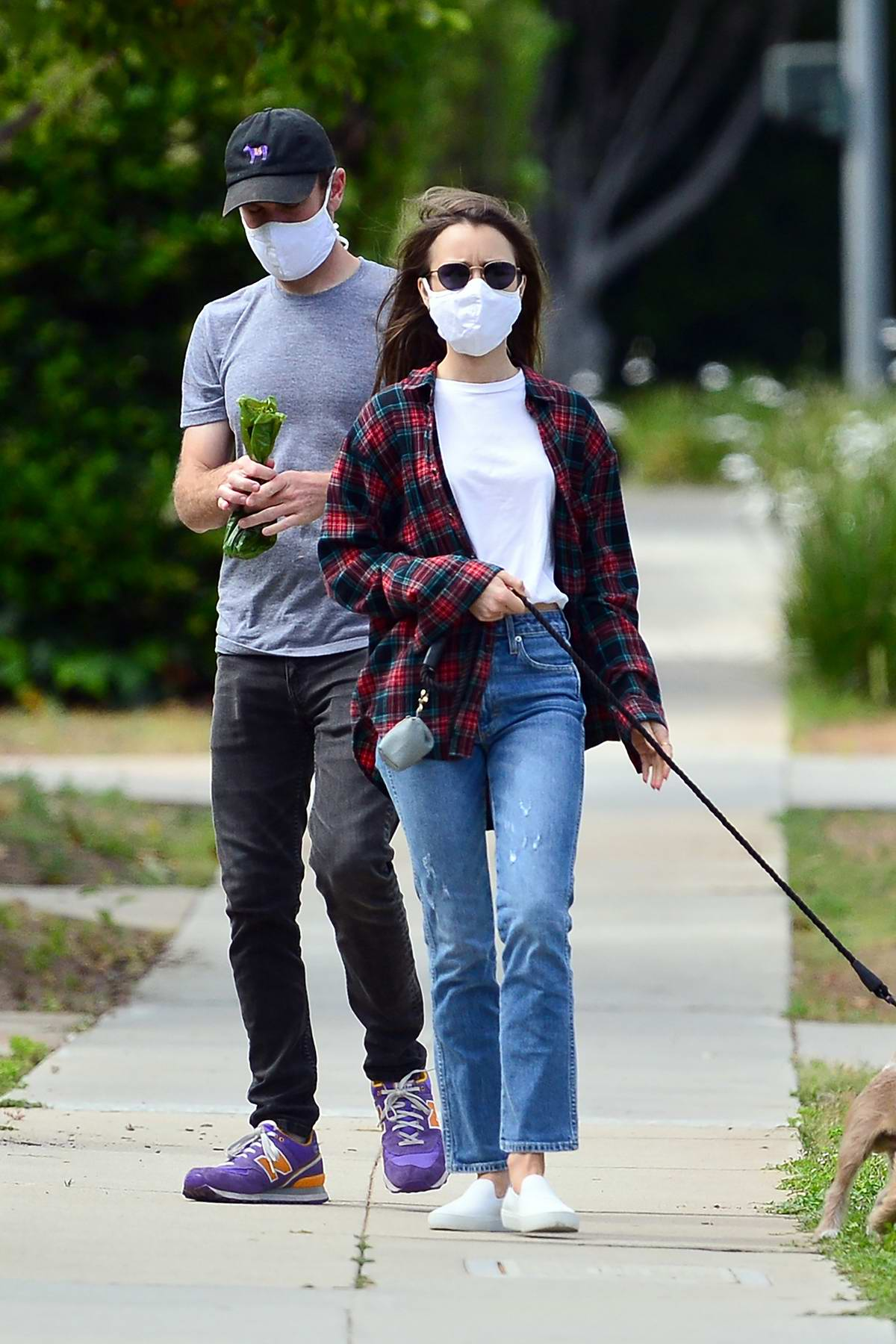 Lily Collins and boyfriend Charlie McDowell step out for an afternoon stroll with their dog in Beverly Hills, California