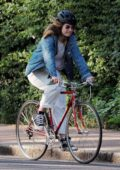 Lily James and Matt Smith go for a bike ride together on a sunny day in North London, UK