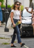 Lily James picks up some flowers while out for some shopping in North London, UK