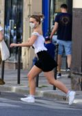 Lily-Rose Depp looks cute in a white top and black mini skirt while out in Paris, France