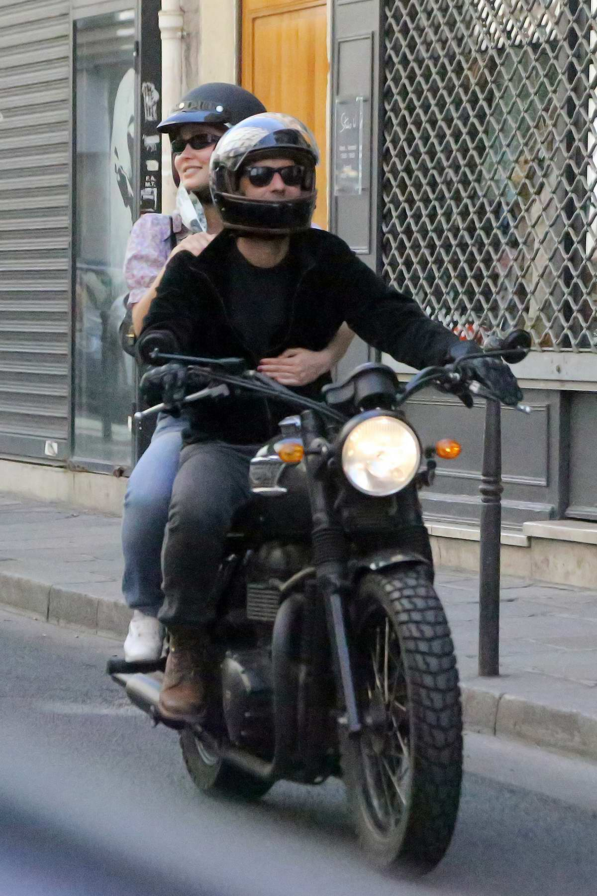 Lily-Rose Depp spotted during motorcycle ride with her stepfather Samuel Benchetrit in Paris, France