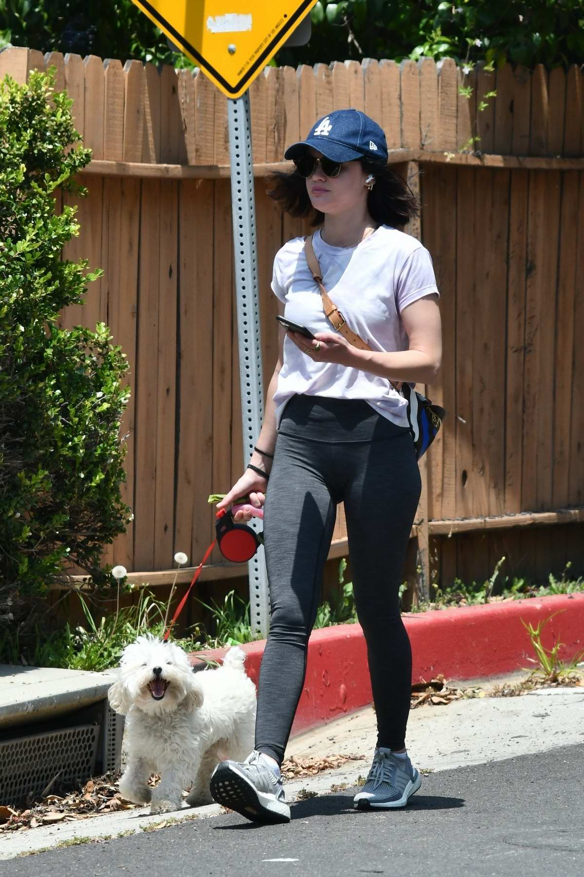 Lucy Hale ditches the mask for a while as she takes her dog Elvis for a walk in Studio City, California