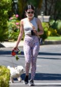 Lucy Hale enjoys a cup of coffee while out walking her dog in Los Angeles