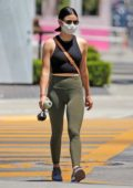 Lucy Hale rocks a crop top and olive green leggings during a juice run at Kreation in West Hollywood, California