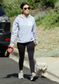 Lucy Hale rocks a hoodie, tank top and leggings while taking her pup out for his daily walk in Los Angeles