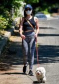 Lucy Hale shows off her fit figure as she goes on a walk with her dog Elvis in Studio City, California