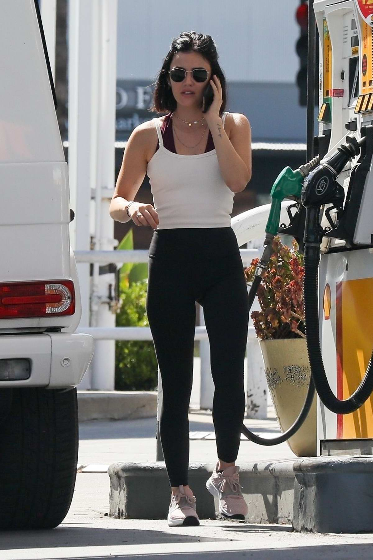 Lucy Hale shows off her slender figure as she stops at a gas station while running a few errands in Beverly Hills, California
