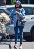 Lucy Hale wears a denim jacket and blue leggings as she goes grocery shopping in Los Angeles