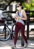 Lucy Hale wears a tank top and burgundy leggings as she enjoys her daily hike in Los Angeles