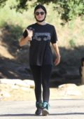 Lucy Hale wears an Alabama concert tee with leggings and ankle weights for a hike in Hollywood Hills, California