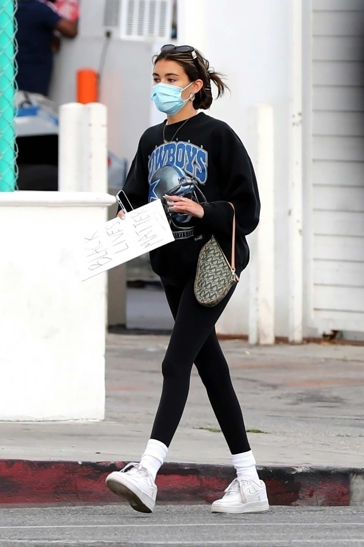 Madison Beer seen heading back to her car after the protests in West Hollywood, California