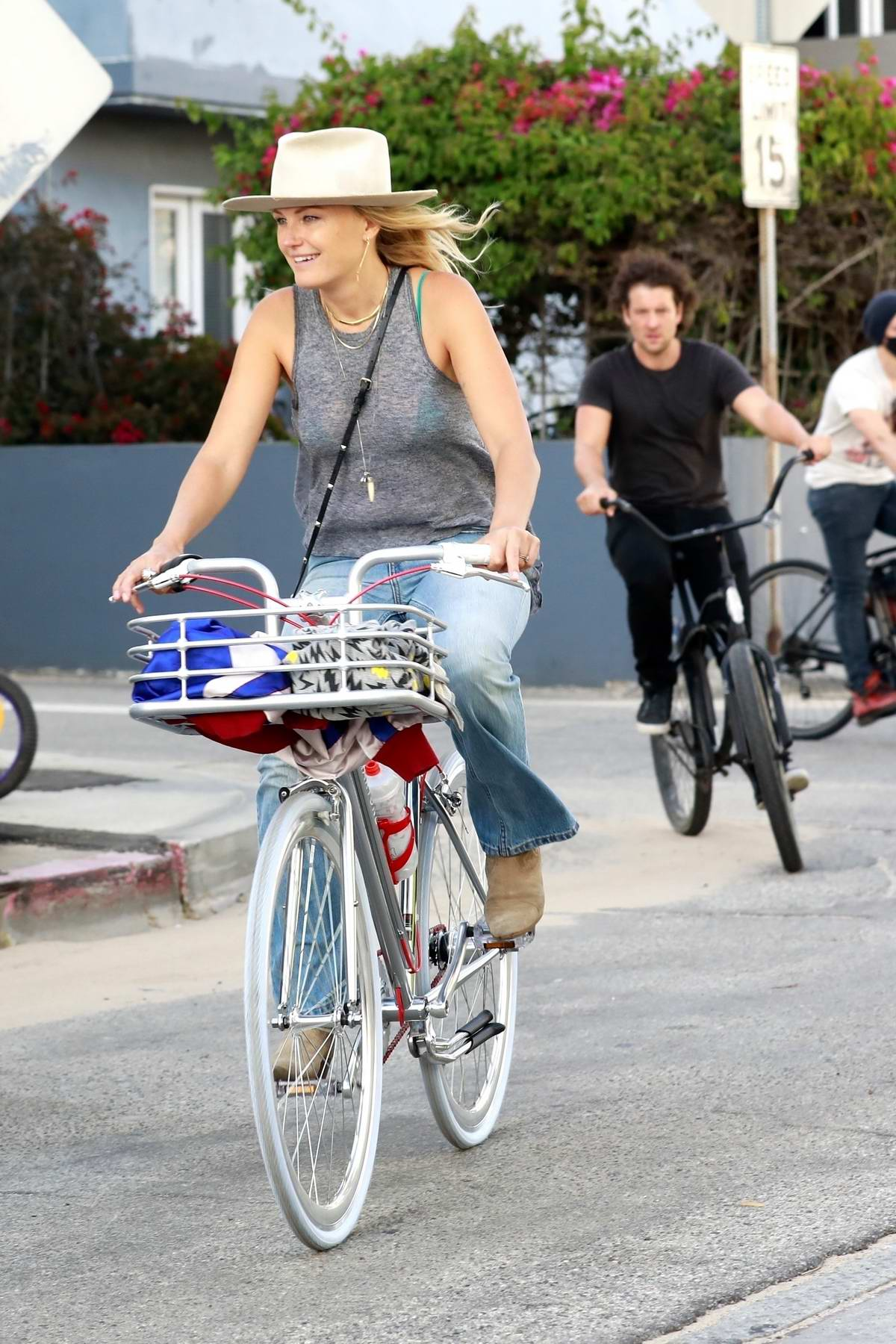 Malin Akerman enjoys a bike ride with her husband and sister in Venice, California