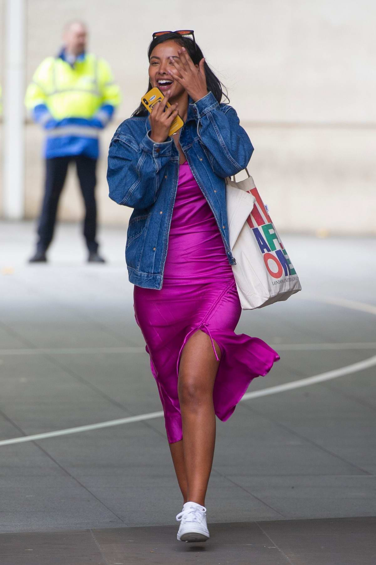 Maya Jama seen wearing a magenta pink slit dress as she arrives at BBC Radio One studios in London, UK