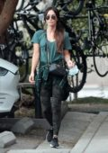 Megan Fox looks sporty in a green top and camo leggings while out with her kids in Calabasas, California