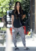 Megan Fox sports animal print pants with a black top while out running errands in Los Angeles