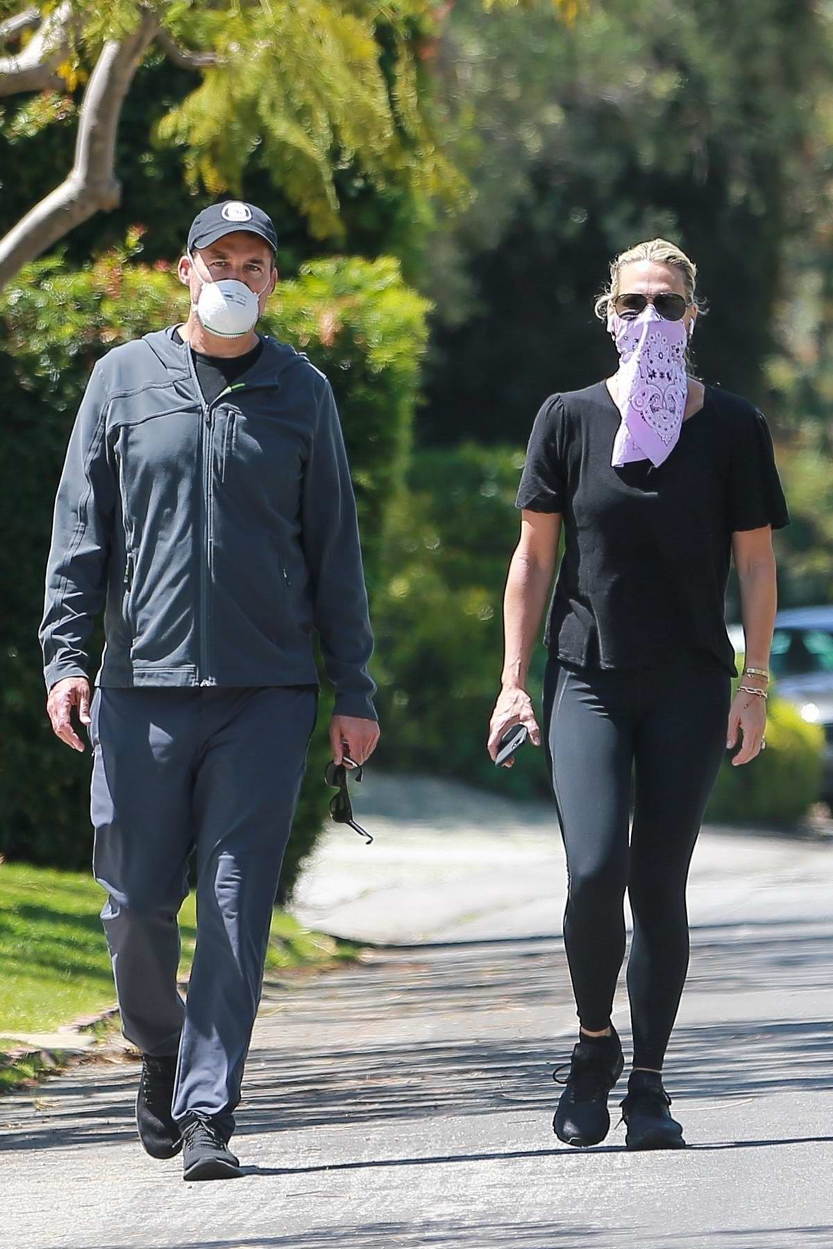 Molly Sims steps out for a casual stroll with her husband Scott Stuber in Santa Monica, California