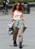 Myleene Klass looks great in semi-sheer top and khaki pants while arriving at Smooth studios in London, UK