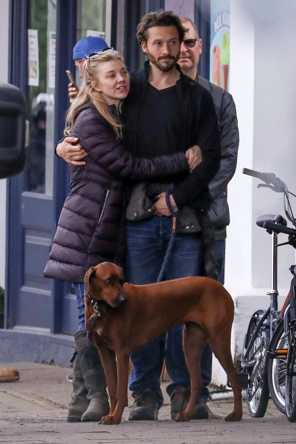 Natalie Dormer packs on some PDA with David Oakes while waiting in line for lunch and coffee in London, UK