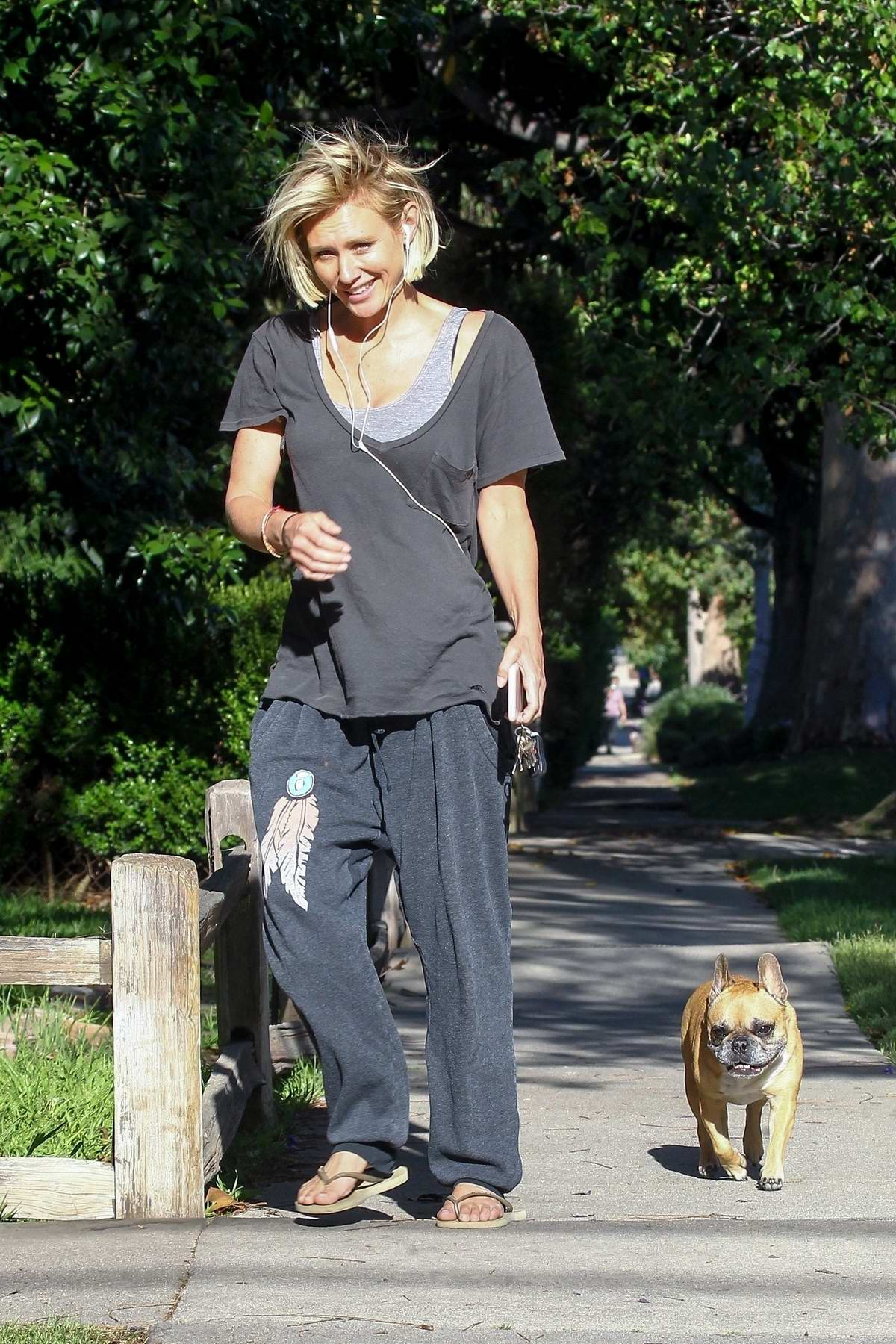 Nicky Whelan keeps it casual and make-up free while walking her dog in Sherman Oaks, California