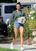 Nina Dobrev flaunts her toned legs in denim shorts as she arrives to a house party in Santa Monica, California