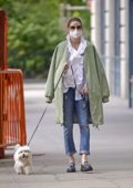 Olivia Palermo looks chic as she steps out to walk her pooch in New York City