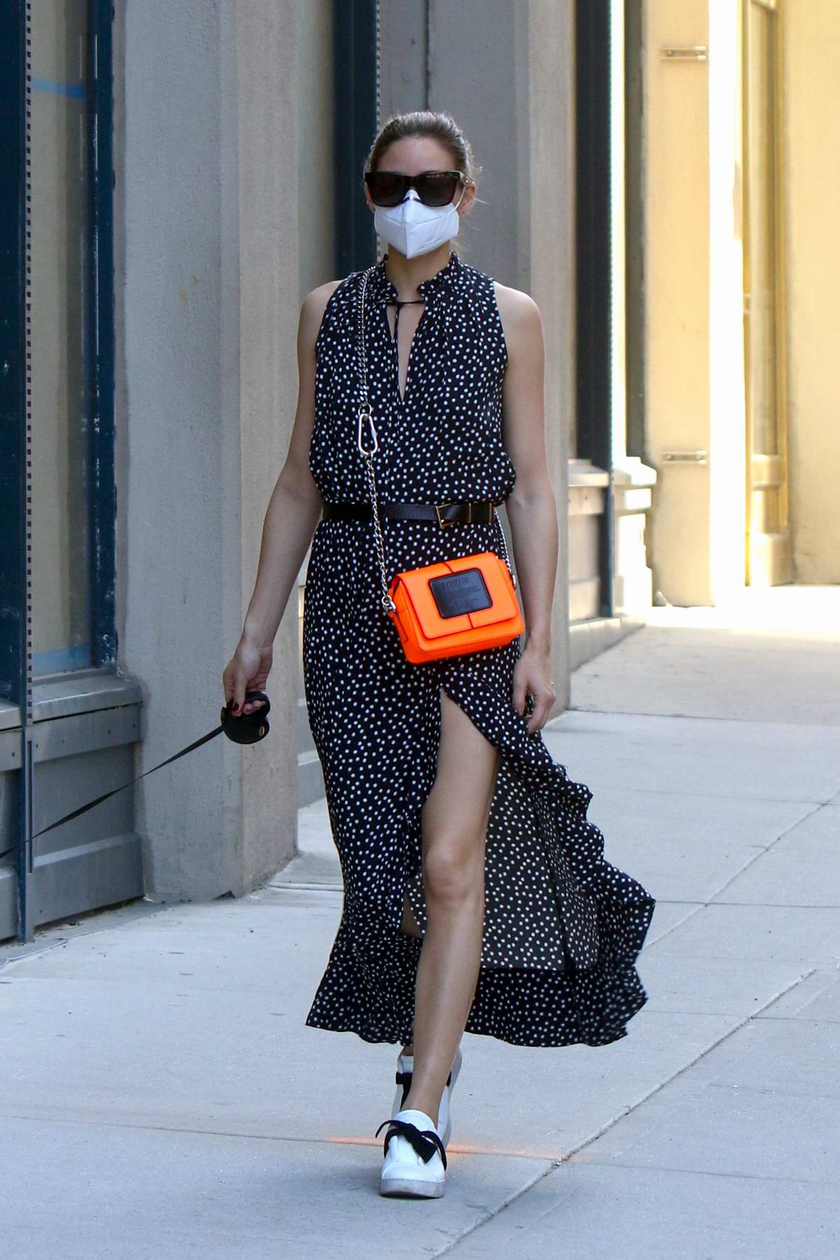 Olivia Palermo looks stylish as she takes her dog Mr Butler out for a walk in Downtown, Manhattan, New York City
