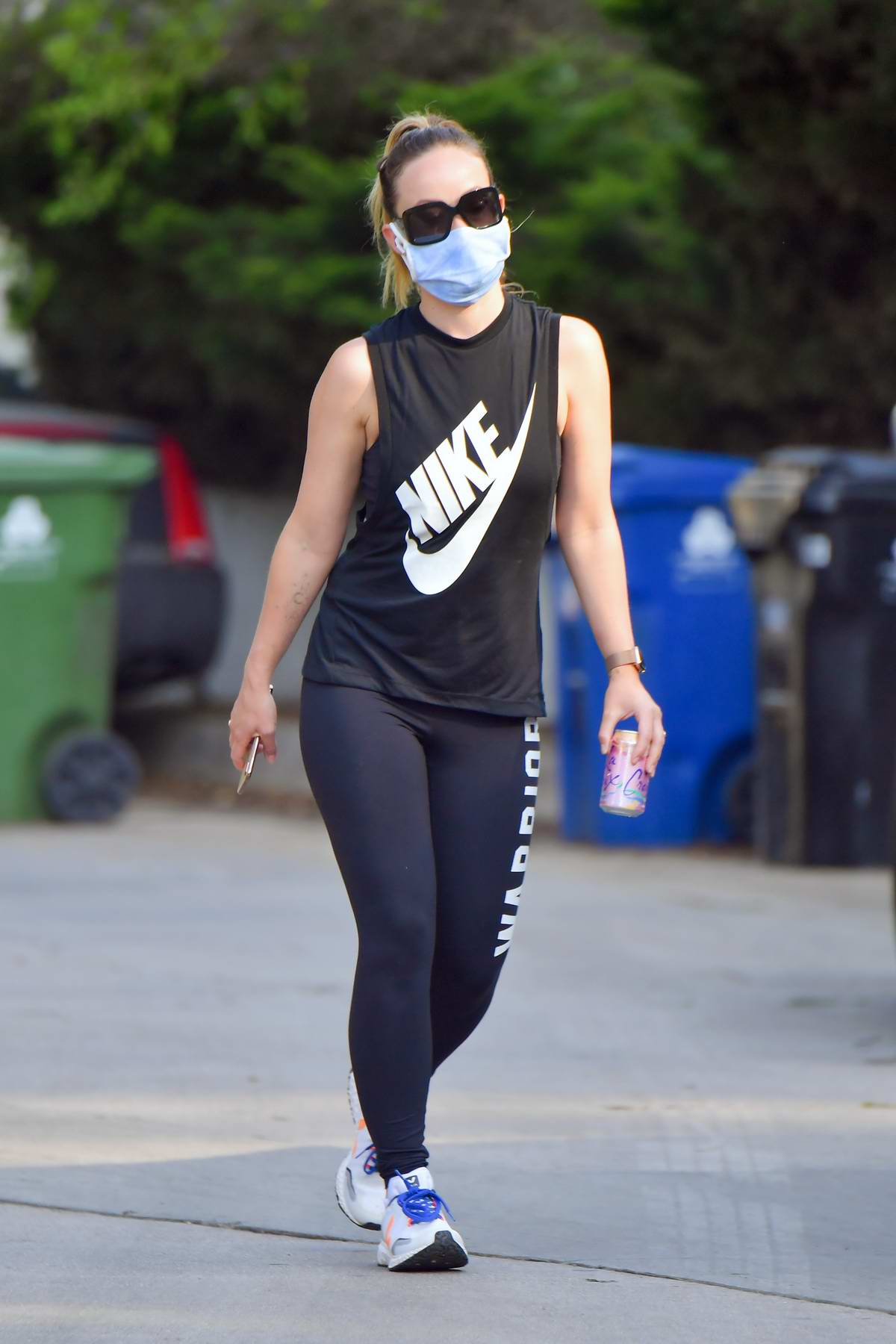 Olivia Wilde looks fit in a Nike top and leggings as she heads out on an evening hike in Los Angeles