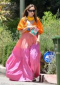 Olivia Wilde looks stunning in a colorful dress as she attends a birthday party with her daughter in Los Angeles