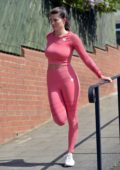 Rebecca Gormley sports coral pink activewear during an outdoor workout session in Newcastle, UK