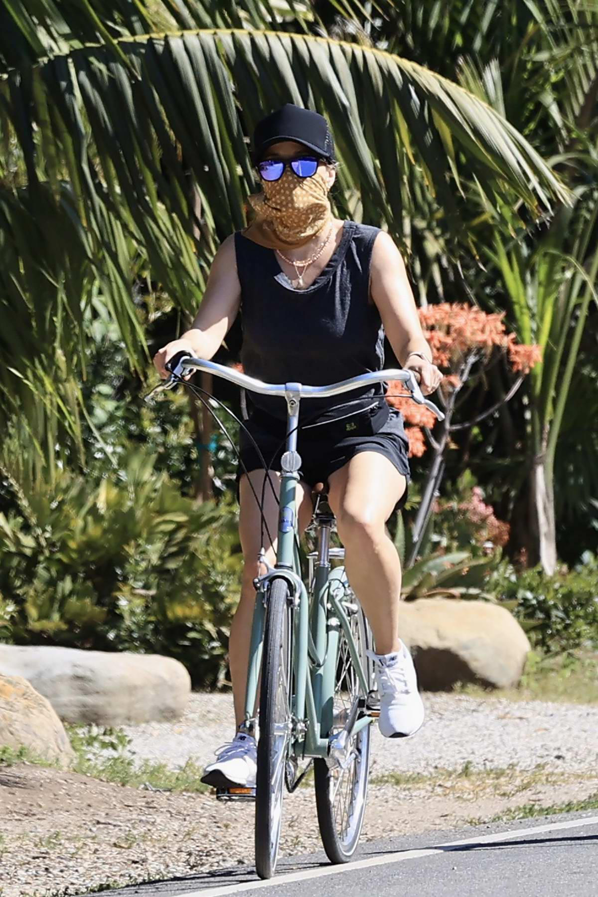 Reese Witherspoon enjoys a bike ride with her son Deacon Phillippe in Malibu, California