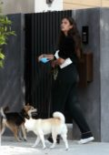 Sara Sampaio dresses in all-black as she steps out to walk her dogs in Los Angeles