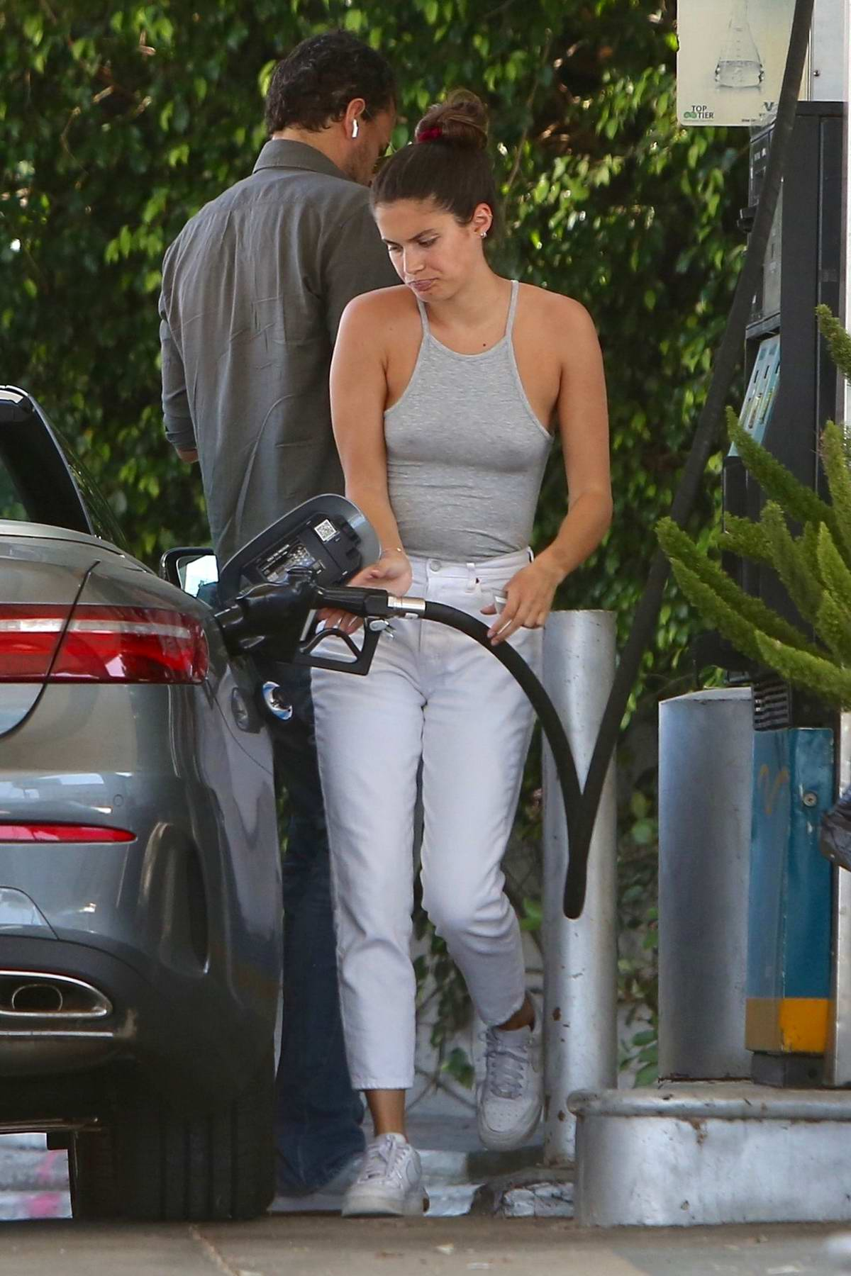 Sara Sampaio rocks a tank top as she stops to fill up her car at a gas station in West Hollywood, California