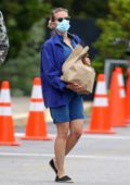 Scarlett Johansson sports a denim romper with matching jacket during a grocery run in East Hampton, New York