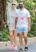 Sophie Turner wears an oversized plaid shirt and pink bunny slippers while out for walk with Joe Jonas in Encino, California