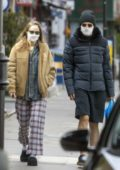 Suki Waterhouse and Robert Pattinson wore matching face masks as they headed out for a stroll in London, UK