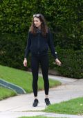 Troian Bellisario steps out for a walk with her daughter and their dog in Los Angeles