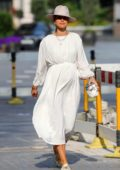Vogue Williams shows her growing baby bump in a white dress as she leaves Heart Radio in London, UK