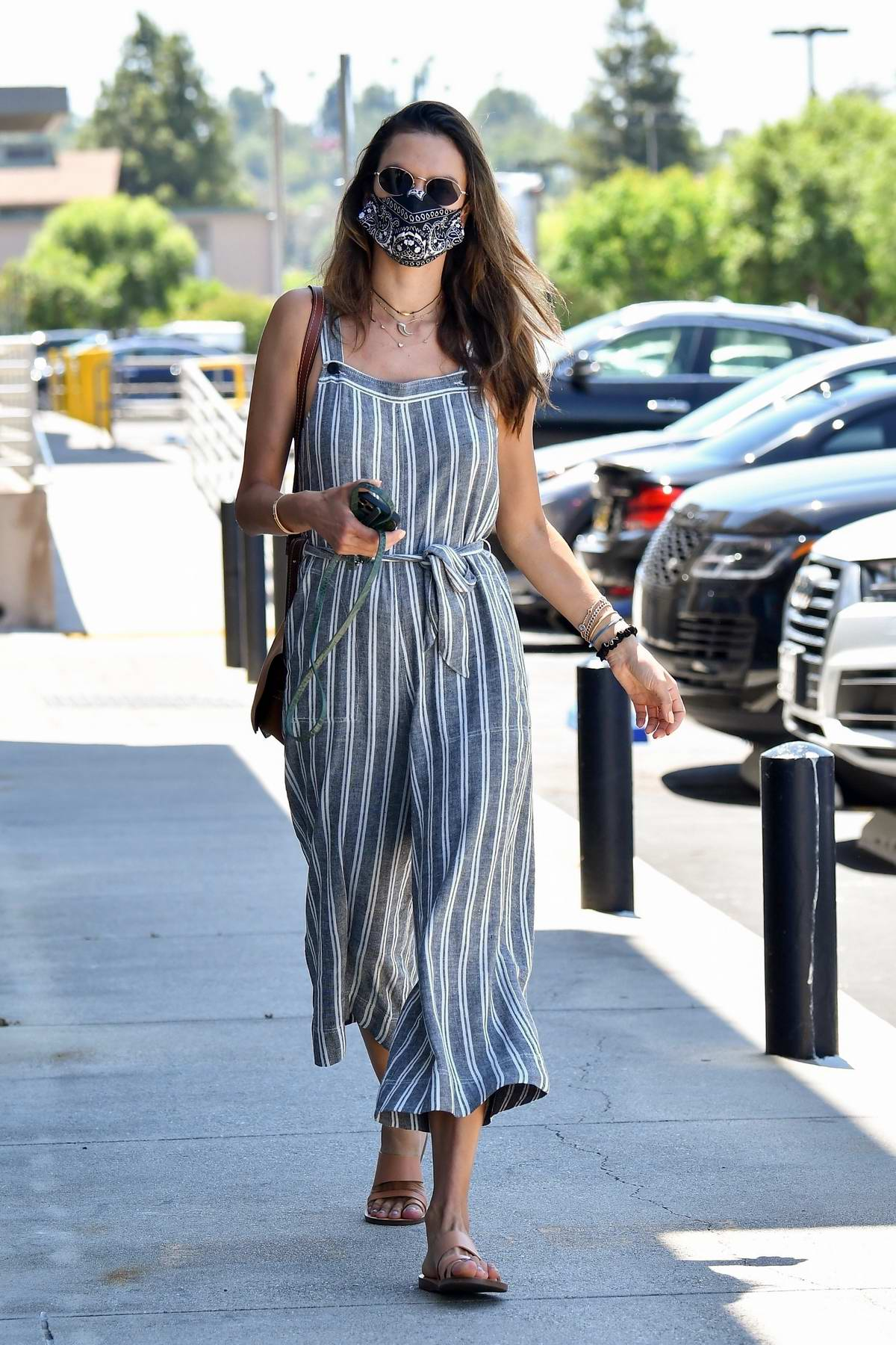 Alessandra Ambrosio looks chic in striped jumpsuit while making a trip to DermaCare Facial Clinic spa in Woodland Hills, California