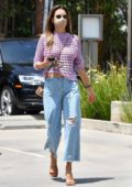 Alessandra Ambrosio looks stylish in a knitted sweater and ripped jeans while out shopping in Brentwood, California